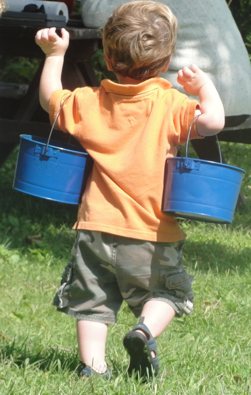 CP#2 balances his tin buckets of blueberries