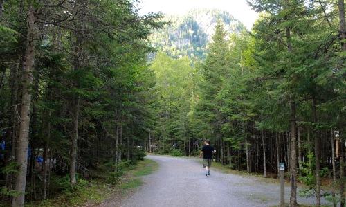 DP walks along the dirt road near our campsite.