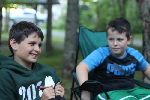 CP#2 and a friend hang out by the campfire.